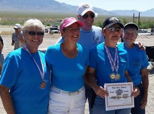 From left to right, Marty Lynch, Debbie Andrews, Coach Lance Barr, Sallie Henrie and Shirlie Kitzmiller feel ecstatic about their fellow club members winning medals at the 2015 Mesquite Senior Games Pistol Shoot.  Photo submitted.