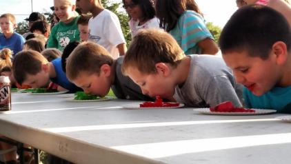 Dozens of kids sit down and prepare to take on the Jell-o eating contest at the Family Fun Night held at the Old Mill Rd Ball Fields April 29. Photo by Stephanie Frehner.