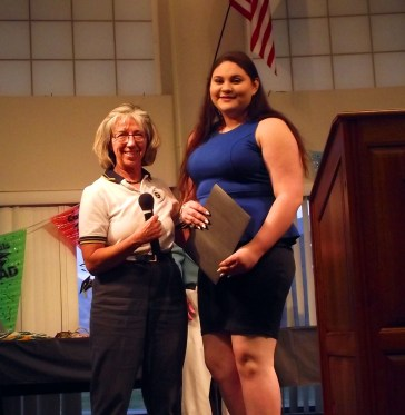 Dr. Peggy Purner awarded the Mesquite Exchange Club's A.C.E. Award (Accepting the Challenge of Excellence) to Yashaira Gonzalez for overcoming adversity and rising to the challenge of graduating and going on to higher education. Photo by Teri Nehrenz.