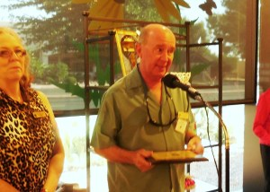 VVAA founder Randy McArthur accepts plaque from current president Jean Wiensch. Photo by Linda Faas.