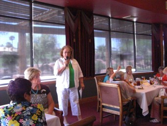 Yoli Bell speaks at the Dames' May luncheon. Submitted photo.