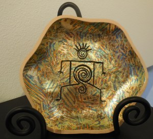 Mother Earth ceramic with foil finish by Judith Hetem. Submitted photo.
