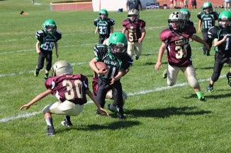 Koby Perry (11) looking for the end zone on a punt return. Photo by Stephanie Montoya.