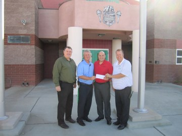 OPD officials present check to VVHS staff. Submitted photo