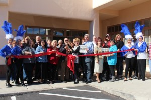 Mayor Al Litman, left center, and Barbara Ellestad, Mesquite Local News Editor, cut the ribbon on the MLN's new office located at 12 W. Mesquite Blvd, Ste. 109. Photo submitted.