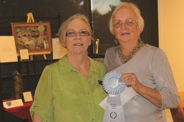 Jean Wiensch, left, presents Jean Battaglia with the People's Choice Award at the October Mesquite Fine Arts Gallery reception on Thursday, Oct. 22. Photo by Barbara Ellestad.