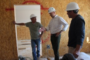 Andre Carrier, center, COO of Rising Star Sports Ranch Resort and Eureka Casino Resort discusses renovation plans of the old Mesquite Star hotel with two construction workers, Ken Howard, left, and Kris Wirth. Photo by Barbara Ellestad.