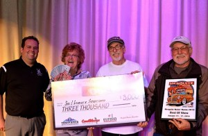 Mesquite Mayor Al Litman and Casa Blanca Resort sales manager Christian Adderson present Sly and Shirley Szucsko of Lake Havasu City, AZ with a check for $3,000 for winning the Best in Show Award at the Mesquite Motor Mania classic car show, Jan. 17. Photo by Tyler Cooper, Mesquite Gaming.