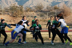 GridironGalsMoapaFootballGame-02-01-16: Bulldog Katie Zuniga #54 splits the Pirate defense after a handoff from quarterback Kallie Graves. Zuniga had four touchdown runs for the Dawgs in a 31-26 win Monday night, Feb. 1 in the Dawg Pound. Photo by Lou Martin.