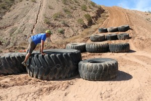 Lincoln Baker, Spartan Race track coordinator, demonstrates just one of 28 obstacles 6,200 runners will face in Saturday's race at the Mesquite MX track and Hafen Ranch near the Palms golf course. Photo by Barbara Ellestad.