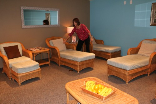 Susan Turner, Spa Manager at the Spa and Salon at CasaBlanca plumps pillows in the soothing relaxation room in which fresh fruit-infused water or hot tea, fresh fruit and soothing music are all provided by the spa. Photo by Barbara Ellestad.