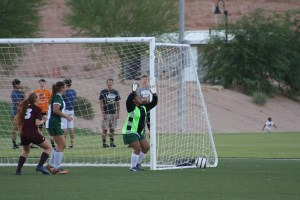 New Bulldog goalkeeper Kristina Anguiano sets up to block a goal shot against Pahrump Valley Friday night, Aug. 26 during the Mesquite Cup soccer tournament. Anguiano had six saves for the Dawgs. Photo by Lou Martin