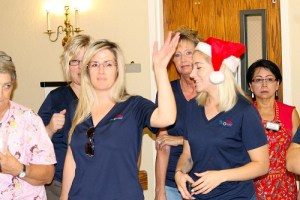 Santa's Helpers from Colonial Property Management spread holiday cheer throughout the halls of Highland Manor as they helped residents celebrate Christmas in July on July 27.  Photo by Teri Nehrenz