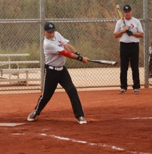 """Ken Kazmaki of Global Force of Burnaby Canada strikes a single during their game with the Rogues of Medford, Oregon Tuesday morning. """"We've been together for 15 years just friends loving softball,"""" said Kazmaki. Photo by Lou Martin"""