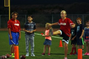 Brooklin Montoya winner in the 10-11 year girl category kicks at the recently completed NFL Punt, Pass and Kick competition. Montoya, last year's sectional winner, will attempt to repeat at this year's event. Photo by Lou Martin