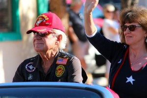 The 2016 Mesquite Veteran's Day Parade Grand Marshall, Retired Marine Corp. Captain T.J. Richardson and his escort. Photo by Teri Nehrenz