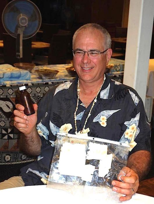 Amelia Earhart Message in a Bottle: Tom Jagger with the message in a bottle he found while looking for Amelia Earhart.