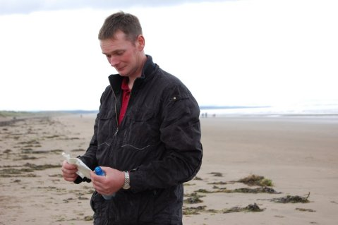 1985 Message in a Bottle - Donald Wylie with his message on the St. Andrews beach where it was found.