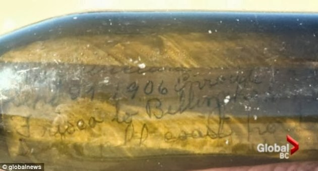 107 Year Old Message in a Bottle: Close up of message inside bottle.