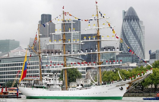 Sailors standing on ARC Gloria's rigging in London. Photo: Daily Mail / PA.