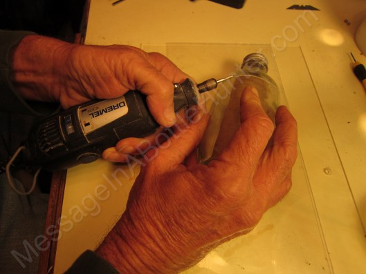 Bob Buffington cutting open ARC Gloria message in a bottle with dremel tool 2