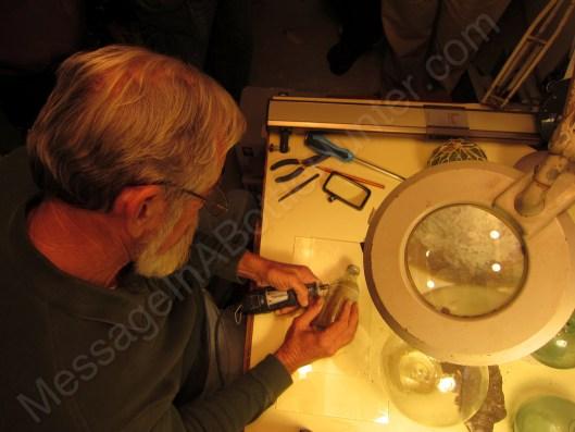 Bob Buffington cutting open ARC Gloria message in a bottle with dremel tool 1