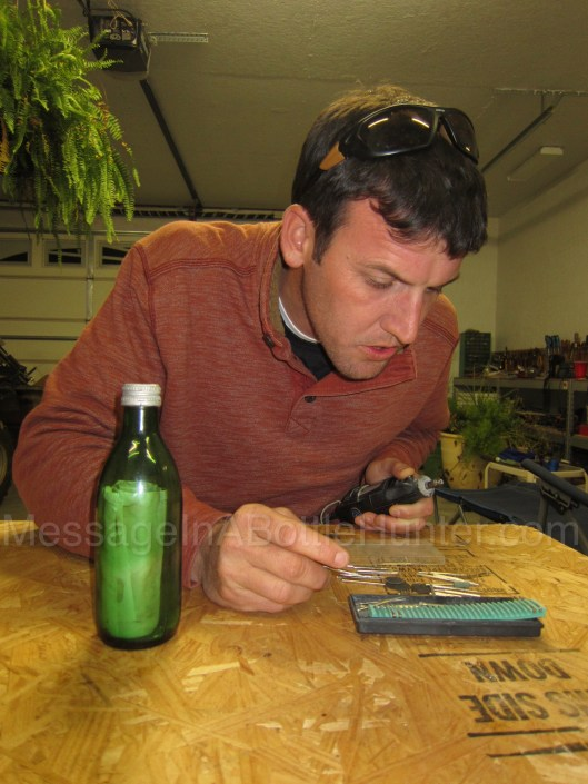 Evan picking Dremel tool to open German message in a bottle