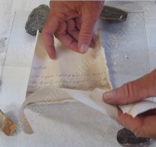 Unfolding main paper of 1985 Nova Scotia message in a bottle 3.
