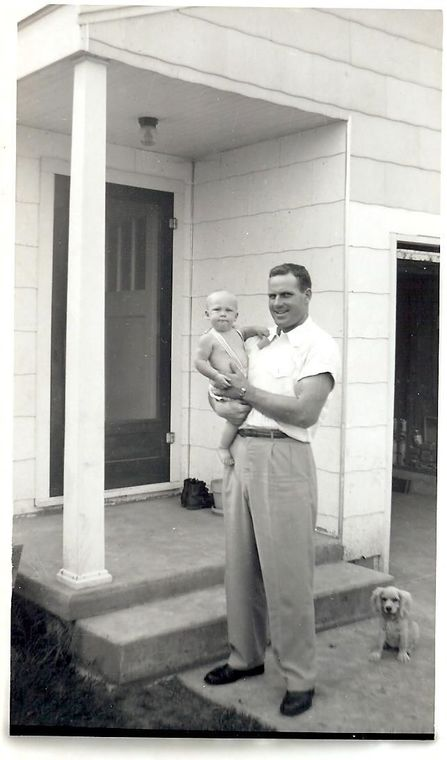George Robbins II as a baby in his uncle Victor Elliot's arms.