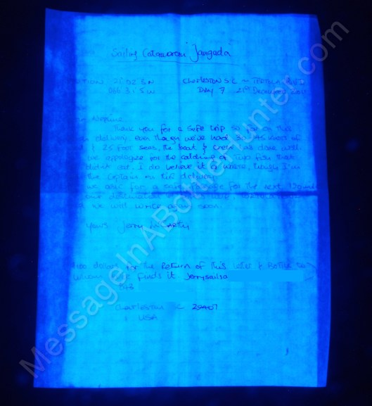 Jerry McCarthy the sailor's message in a bottle under UV black light.