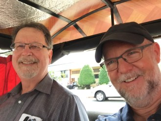 Phil Kurpe and I riding in a Songteaw.