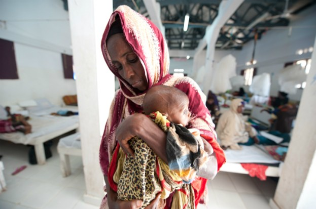 A mother at Kismayo General Hospital's stabilisation centre holding her malnourished child. The centre is supported by the International Committee of the Red Cross (Credit: ICRC/Pedram Yazdi)