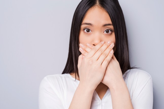 woman-covering-mouth