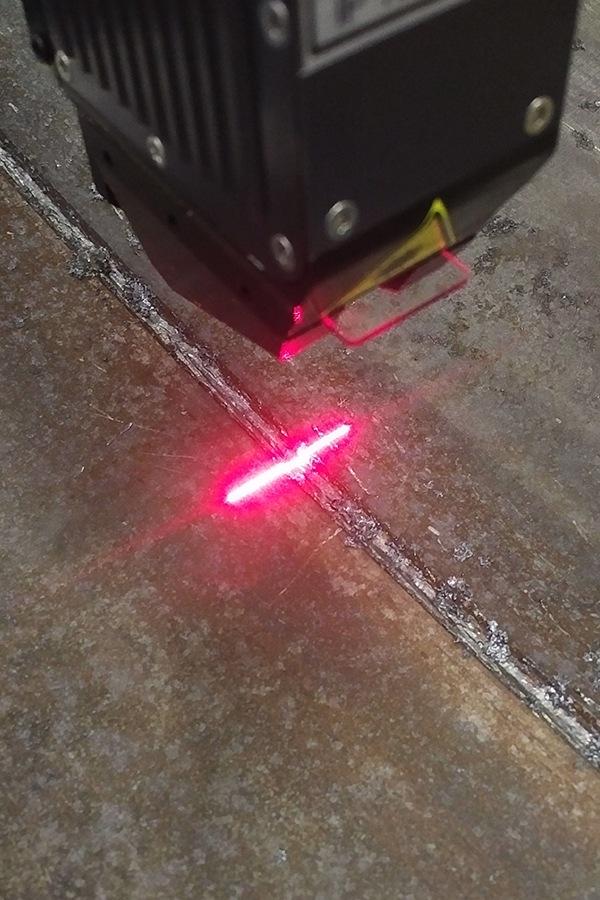 Smart laser sensor finding defects in a weld