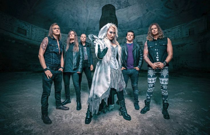 Battle Beast Photo of the band in what appears to be a cave of some sort.