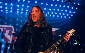 David Silver of Savage Messiah onstage playing guitar with his mouth open