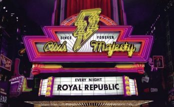 Royal Republic Club Majesty album artwork. The picture is of an American style theatre or nightclub with the name Club Majesty as a huge neon yellow sign with lightning bolt surrounded by pink neon borders. Underneath is the type of board where you can change the letters - it reads Royal Republic