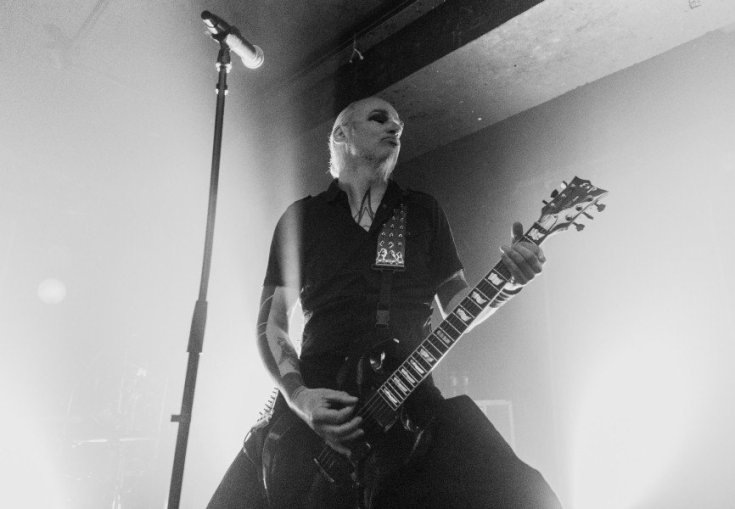 Photo of Vorph from Samael playing guitar.