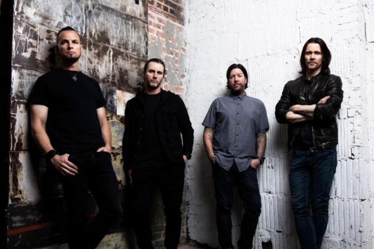 Alter Bridge band promo image, band members, industrial background