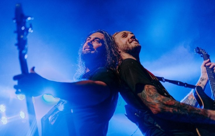 Colour photo of Bad Wolves' bassist and guitarist playing back to back