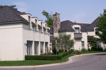 These mediterranean-styled condominiums are finished wtih a black steel shingle roof by Metal Roof Outlet in Ontario.