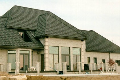 This gorgeous and stately Ontario home is protected from the elements by Metal Roof Outlet's steel continental tile. Notice how our expert installation team easily navigated the steep slopes, irregularities, and skylights!