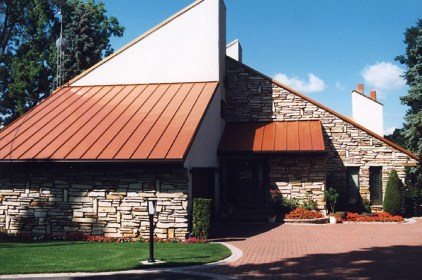 The unique modern architecture of this home allows for a utilitarian style rust-coloured steel sheet roof from Metal Roof Outlet.