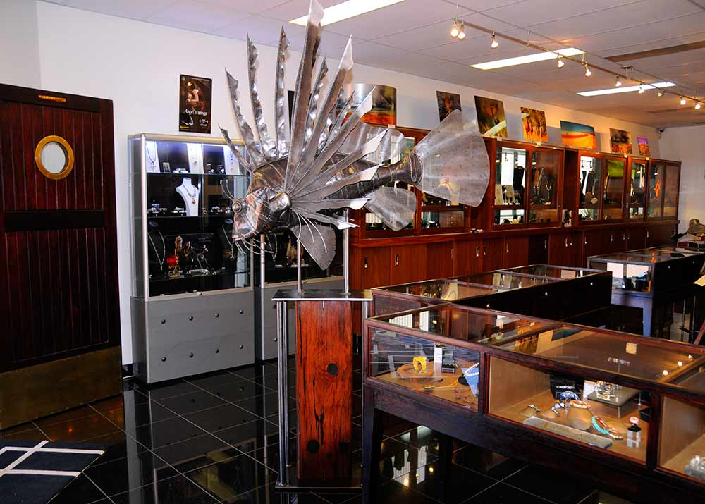 Metal Sculpture Lionfish on timber stand in gallery