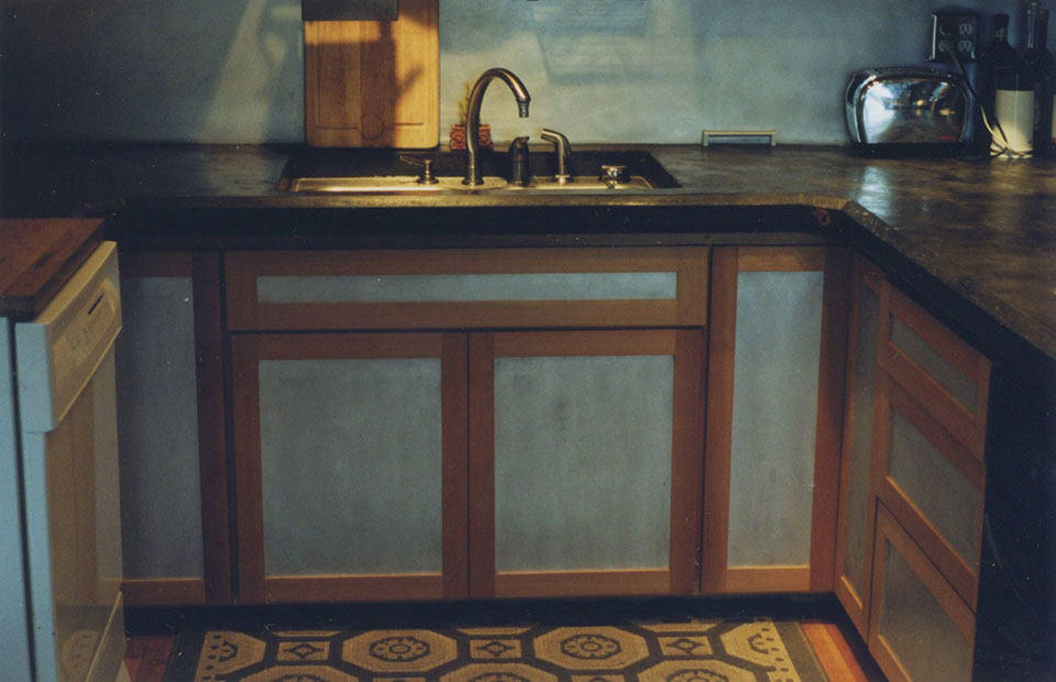 Hemlock and aluminum cabinets with concrete countertops