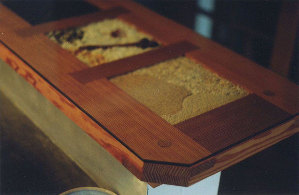 Bar top from Douglas fir and glass and dried grains