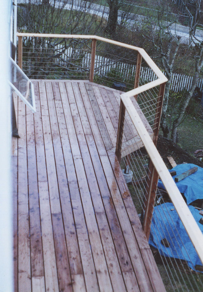 Deck with rope and yellow cedar railing