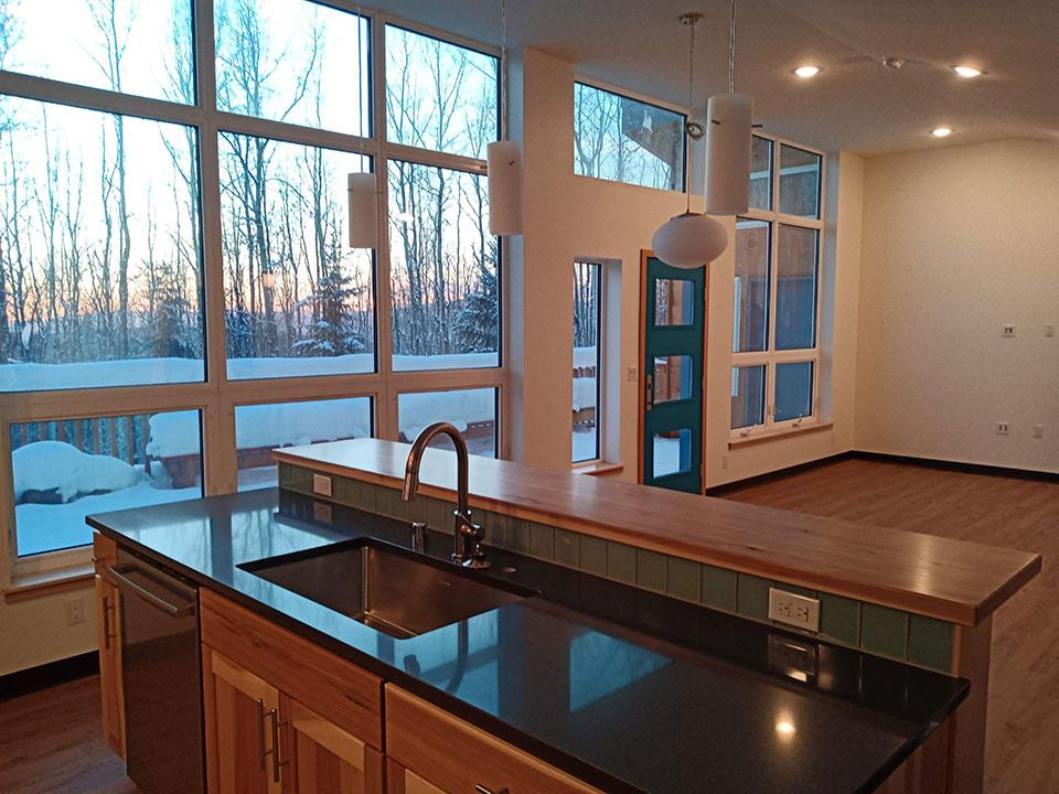 Quartz countertop, glass tile backsplash, hickory cabinets and bartop