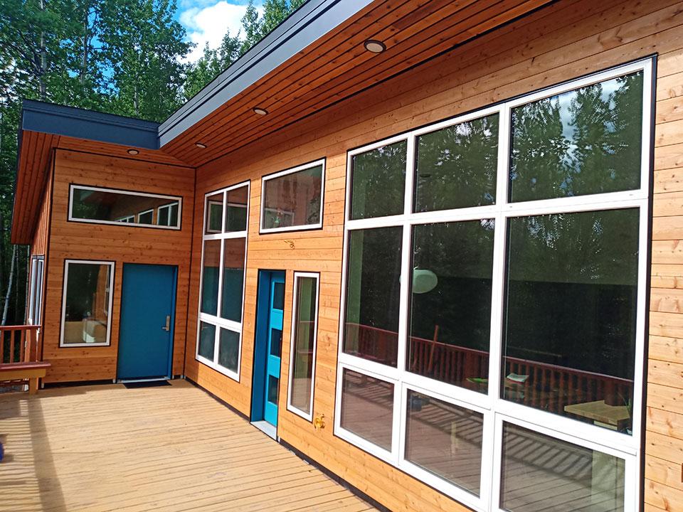 Fine-line cedar siding, metal trim, cedar soffit