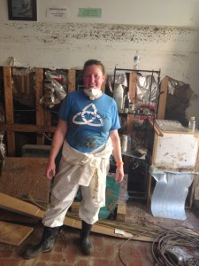 Kim Feldman mudding out Great Panes, a business on Main Street. (Notice the mud line on the wall behind her!)